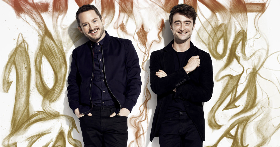 Daniel Radcliffe ao lado de Elijah Wood