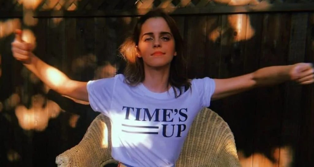 Emma Watson wears a T-shirt to support the march Time's Up, against sexual harassment in the film industry