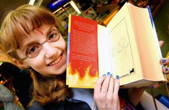 Teen Evanna Lynch holds her autographed copy of Harry Potter and the Order of the Phoenix