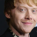Rupert Grint says he's never watched all the Harry Potter movies and doesn't expect an invitation to TV series